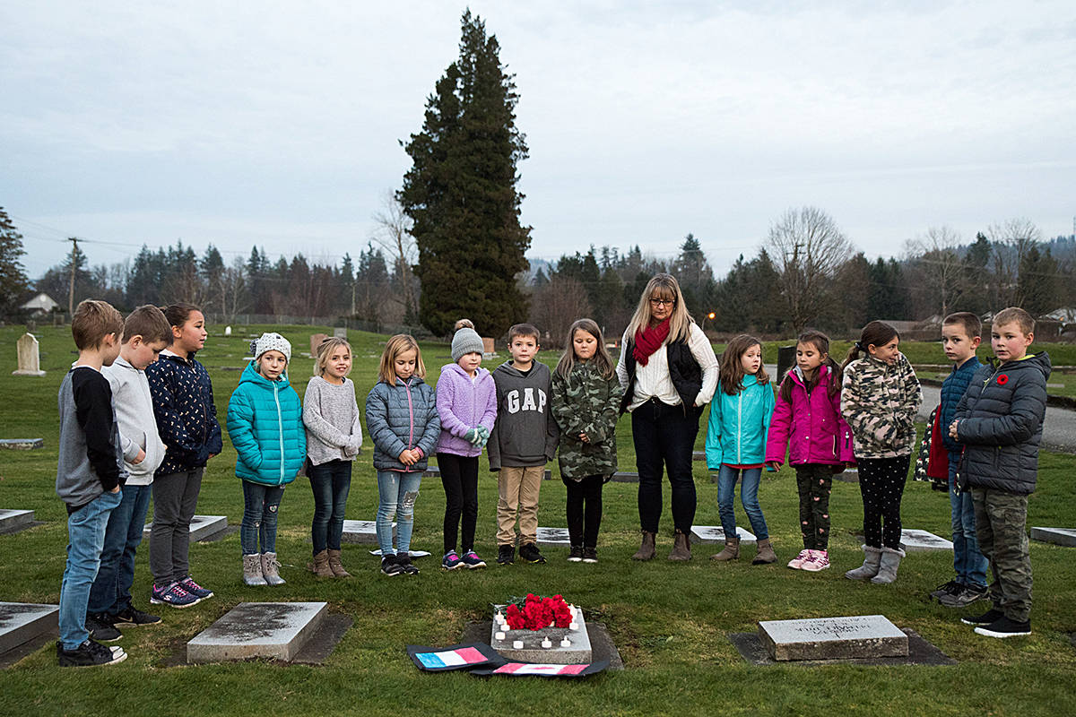 Debbie Mar's Grade 3/4 class at an Abbotsford soldier's grave during their field trip to Hazelwood Cemetery. Photo courtesy of Ashley Martens.