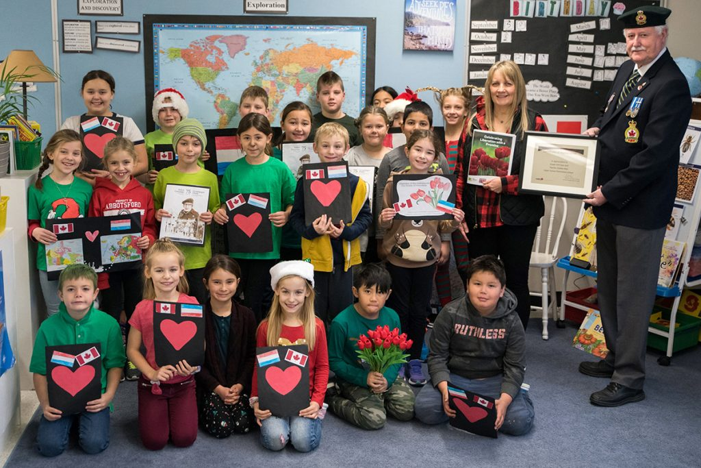 The Grade 3/4 class with Mar and Sgt. Kelly Watson. Ashley Martens photo.