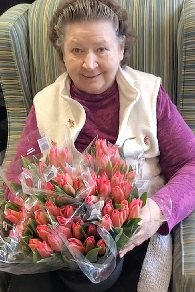 lady with tulips in elderly care home